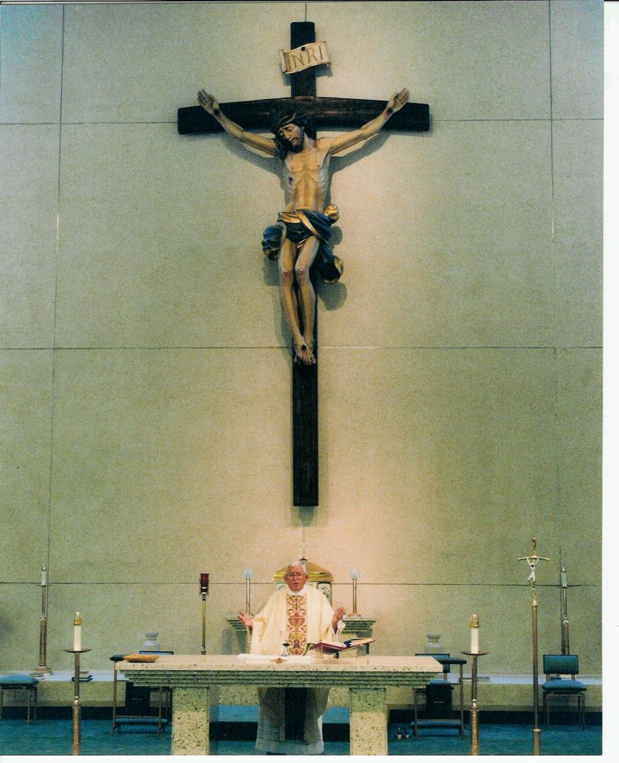 Original carved wood crucifix for Holy Family Church in